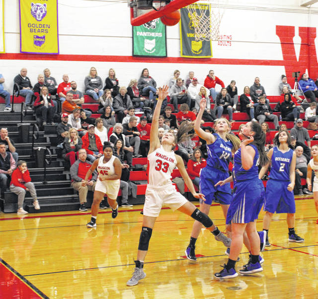 Sam Aeschliman of Wauseon drives to the basket and scores during Tuesday's game.