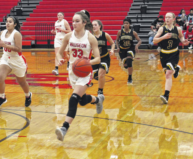 Sam Aeschliman of Wauseon leads a charge up the floor as she finishes off a fast break opportunity during Tuesday's game against Pettisville. The Indians ran away from the Blackbirds in the second half, picking up a 49-24 victory.