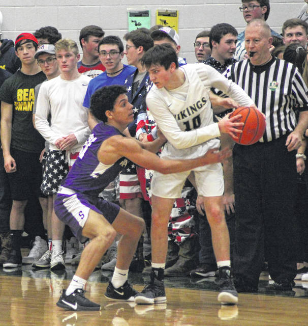 Swanton's Justyn Bartlett defends against Jack Etue of Evergreen on Friday.