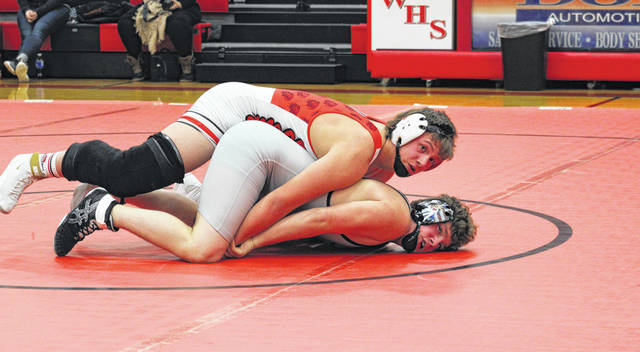 Jarrett Bischoff of Wauseon holds down Kaden Bergstedt of Liberty Center during Thursday's NWOAL match. He was one of six Wauseon seniors honored on Senior Night, all of whom wrestled in the dual.