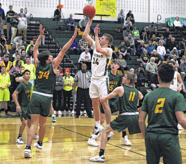 Nate Brighton of Evergreen with a basket versus Clay on Monday.