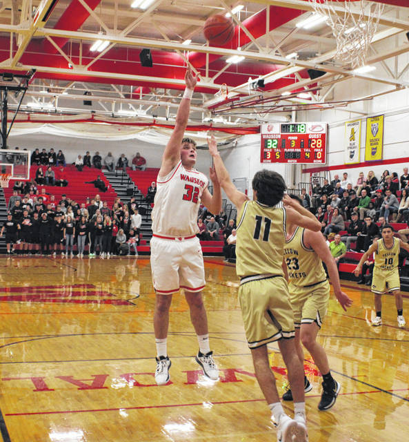 Sean Brock of Wauseon puts up a shot over Perrysburg's Drew Paule (11) during Tuesday's non-league boys basketball contest. Brock finished with 13 points while helping to lead the Indians past the previously unbeaten Yellow Jackets, 50-39.