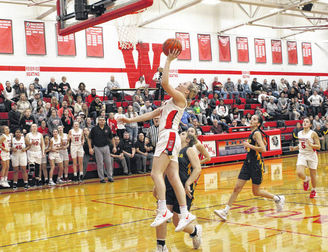 Chelsie Raabe scores after a Wauseon steal in the final minute of the third quarter during Friday's NWOAL meeting with Archbold. The Indians trailed by as many as 13 points in the first half, but fought back in the second to earn a 48-45 win.