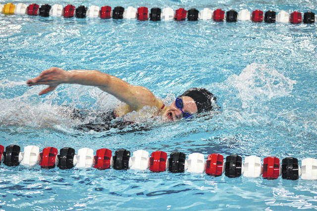 Grace Rhoades of Wauseon competes in the 500-yard freestyle during Tuesday's tri-meet with Bryan and Oregon Clay. The Wauseon girls earned a pair of wins, while the boys defeated Clay but fell short against Bryan.