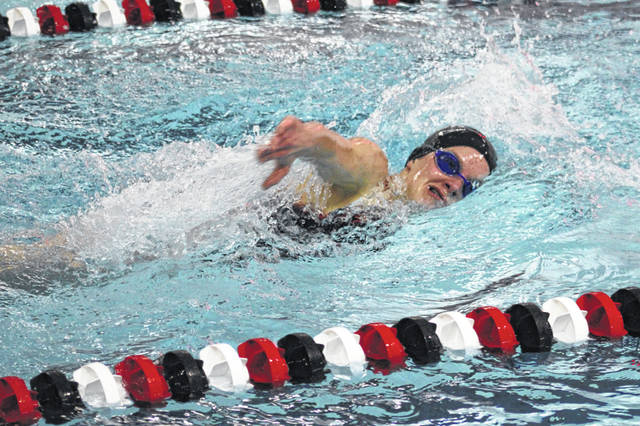 Grace Rhoades of Wauseon swims during a home meet on Jan. 7. She won the 200 IM and 500-yard freestyle Tuesday at a meet in Bowling Green.