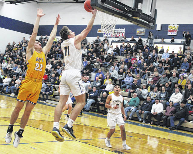 Elijah Zimmerman of Archbold goes hard to the hoop for a layup during Friday's NWOAL battle with Bryan. A strong second half turned in by the Blue Streaks gave them a 43-27 win over the Golden Bears.
