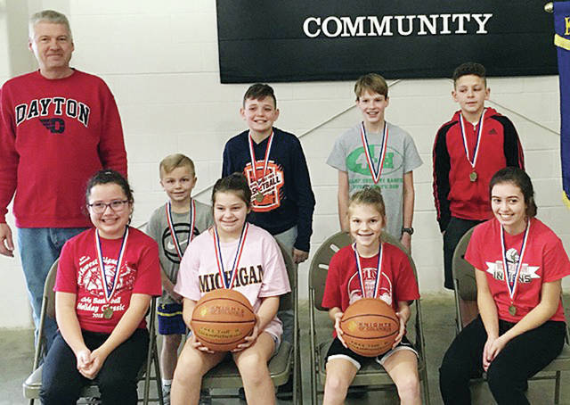 The first place winners of the Ohio Knights of Columbus Free Throw Contest local competition, hosted Jan. 12 by the St. Caspar Catholic Church Knights of Columbus in Wauseon, are all smiles as they advance to the district competition in February. The contest was open to all area boys and girls ages 9-14. Pictured are - bottom row, from left - Sidney O'Dell, Sophia Browning, Kasmyn Carroll, Addy Case - top, from left - K of C representative Gary Kohls, Kowen Carroll, Brody Shehorn, Kyle Galvin, Jamison Knight.