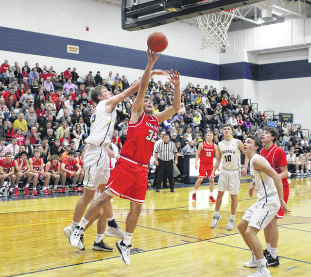 Wauseon's Sean Brock with a basket in a NWOAL game at Archbold earlier this season. The Indians and Blue Streaks, along with other area teams, found out their tournament draw when it was announced on Sunday.