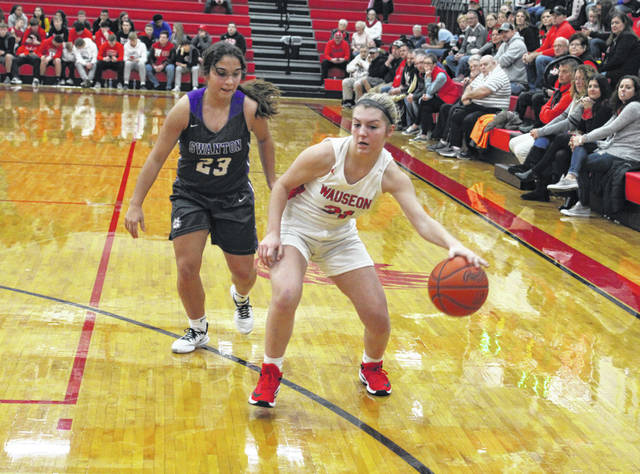 Kadence Carroll of Wauseon handles the ball as Averie Lutz of Swanton defends during an NWOAL contest last week. The Indians are the third seed in the Division II, Paulding District, while the Bulldogs were seeded sixth in the Division III, Anthony Wayne District.