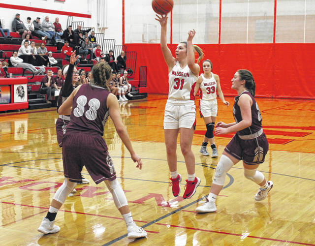 Kadence Carroll of Wauseon puts up a shot from the elbow during Tuesday's non-league battle against Rossford. The Indians defeated the Bulldogs 54-42 to push their record to 18-3 on the season.
