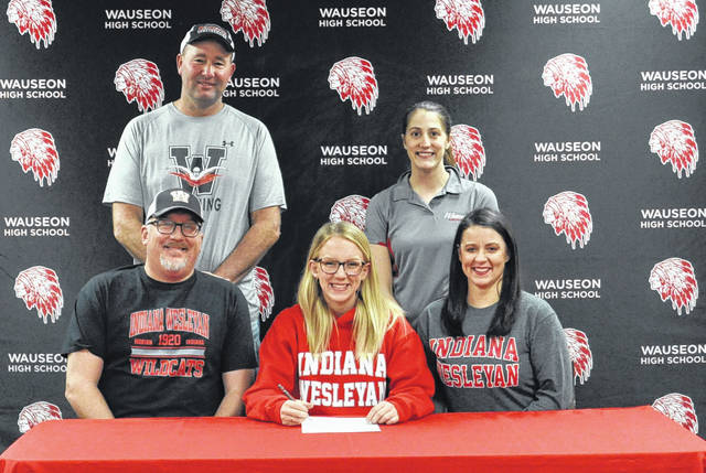 Megan Carroll of Wauseon recently committed to continue her education and swimming career at Indiana Wesleyan University (NAIA) in Marion, Indiana. Front row, from left: David Carroll (father), Megan, Rebecca Carroll (mother). Back row: Wauseon head swimming coach Tony Schuette and assistant coach Brittany Schroeder.