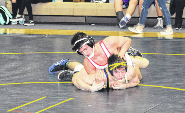 Wauseon's Connor Twigg, top, in control versus Brennan Short in the 145-pound final on Saturday at the NWOAL wrestling tournament. Twigg was one of three champions for the Indians, allowing them to claim their fourth league title in a row.