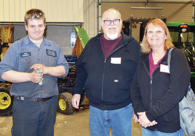 "As part of Career and Technical Education Month, Four County Career Center in Archbold hosted a ""Parents (Grandparents) Day,"" inviting parents and grandparents to visit students' career and technical labs and view their current projects. ""Celebrate Today, Own Tomorrow"" was the theme for the month. Shown in the Agricultural/Diesel Mechanics lab with student Alex Stevens from Wauseon are Cleve Stevens and Shannon Stevens."