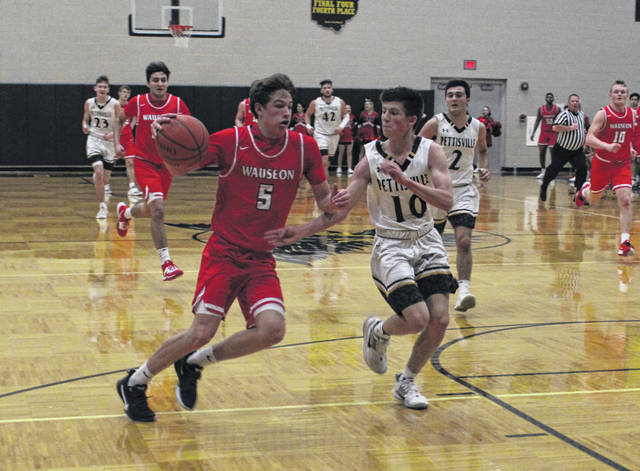 Wauseon's Jonas Tester takes the ball up the floor while being defended by Max Leppelmeier of Pettisville during a non-league contest Saturday night. The Indians held on for a 50-43 win.