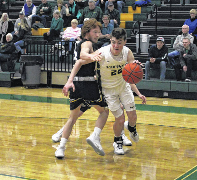Mason Loeffler of Evergreen dribbles around a Pettisville defender in a non-league game this season. He was named NWOAL Player of the Year by league officials.