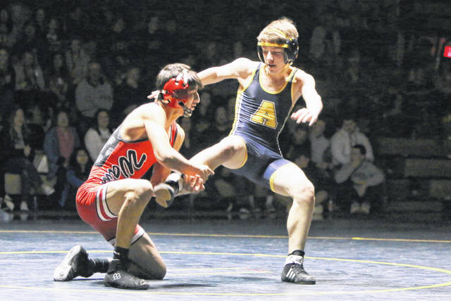 John Martinez of Wauseon, left, looks for a takedown versus Wyatt Armstrong of Archbold in the 120-pound match during Friday night's dual. Martinez would win by technical fall as he was one of 10 Indians to win matches in a 52-13 defeat of the Blue Streaks.