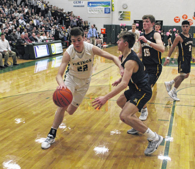 Mason Loeffler of Evergreen drives to the hoop Friday versus Archbold in NWOAL action at Evergreen. The Vikings broke open a close game after halftime, earning a 49-35 win over the Blue Streaks and a share of the league title.