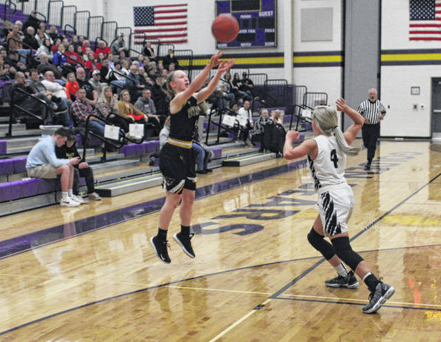 Jessica McWatters of Pettisville puts up a 3-pointer in a Division IV sectional semifinal against North Central Tuesday night. She finished with a game-high 17 points, but the Blackbirds fell short to the Eagles in overtime, 44-38.