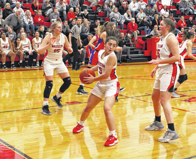 Autumn Pelok of Wauseon secures a rebound during Thursday's NWOAL contest against Patrick Henry. The Indians, who led by double digits for most of the game, fell to the Patriots 38-37.