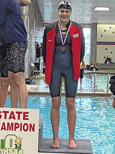 Wauseon's Brooke Schuette stands on the podium following a third place finish in the 200-yard freestyle Friday at the Division II State Swimming and Diving Championships in Canton. She also placed ninth in the 500 freestyle.