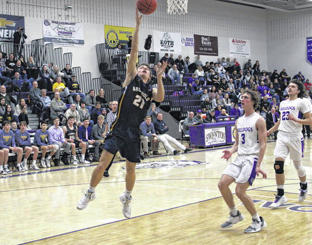 Archbold's Trey Theobald with a basket off a steal Friday versus Swanton in the regular season finale for both teams. The Blue Streaks picked up the road win, 50-39.