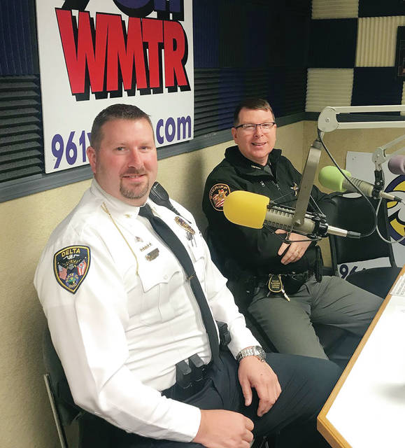Delta Police Chief Nathan Hartsock and Fulton County Sheriff Roy Miller share DJ duties during a past Heart Radiothon.