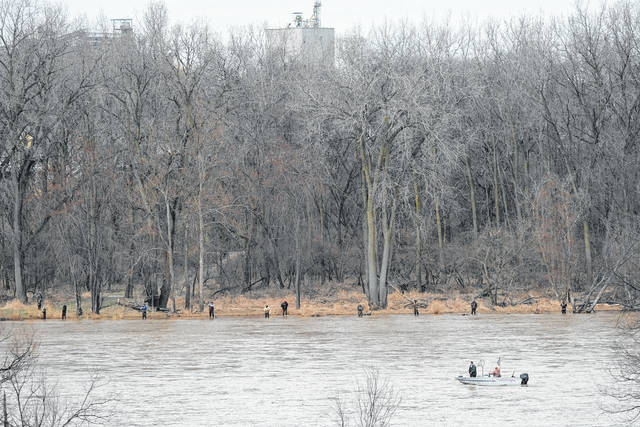 Anglers dot the Maumee River shoreline Sunday afternoon near Maumee.