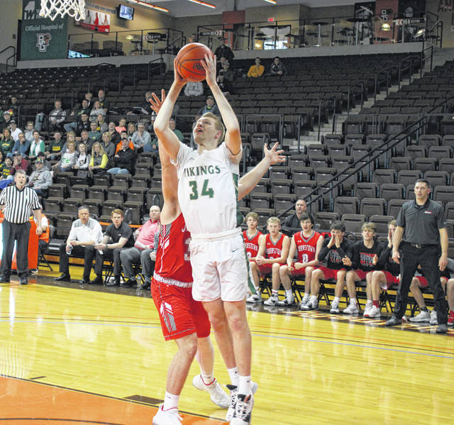 Nate Brighton with a basket for Evergreen during Wednesday's regional semifinal versus Johnstown-Monroe. The Vikings won 64-54 to advance to their first ever regional final; however, the tournament was postponed and a potential makeup date is yet to be determined.