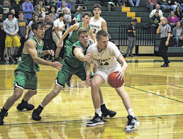 Nate Brighton of Evergreen dribbles the ball near the basket in a Viking home game this season. He was selected first team All-District 7 in Division III.