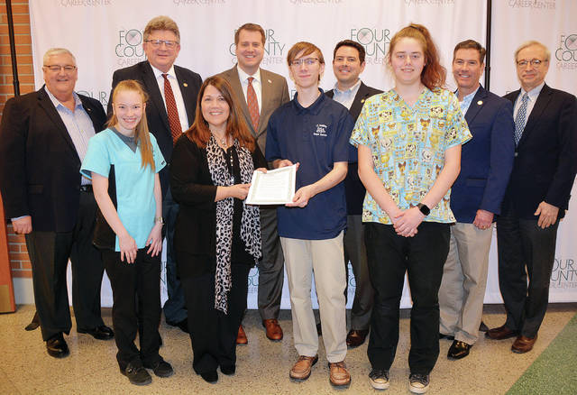 In honor of Career and Technical Education Month, Four County Career Center in Archbold hosted a luncheon for state legislators, local mayors, and county commissioners from the four-county area, prepared by the Culinary Arts Management/Chef Training students and Chef Peter Herold. Students had the opportunity to talk about their programs of study. Pictured are – front, from left – Adriel Nelson of Wauseon; City of Wauseon Mayor Kathy Huner; Breyer Zachrich of Pettisville; Victoria Miller of Evergreen – back, from left – Fulton County Commissioner Jon Rupp; State Representative James Hoops; State Representative Derek Merrin; State Senator Robert McColley; State Representative Craig Riedel; and District Director for Bob Latta's office, David Wirt.