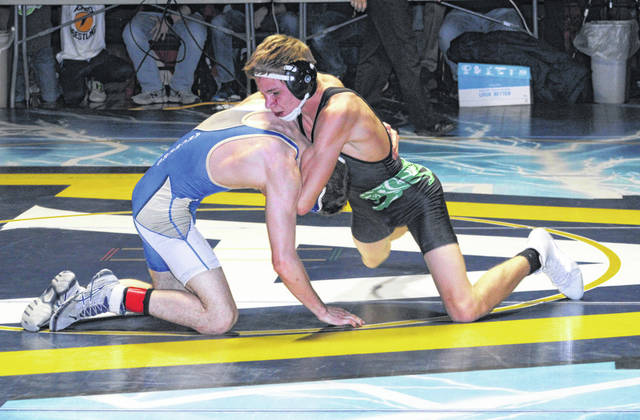 Gabe Meyer of Delta, right, versus his opponent from Antwerp in the 126-pound final in the Division III Archbold Sectional Saturday.