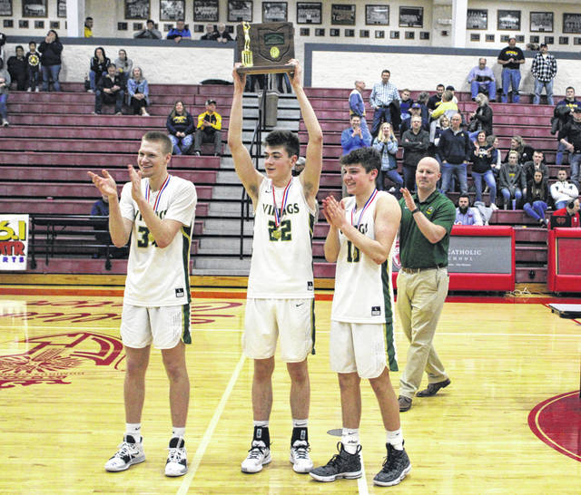 Evergreen seniors Nate Brighton, Mason Loeffler and Jack Etue show off the district championship trophy to the Viking fans following Saturday's win over Archbold in the district title game. The Vikings now advance to the Division III regional at BGSU Wednesday where they will face Johnstown-Monroe.