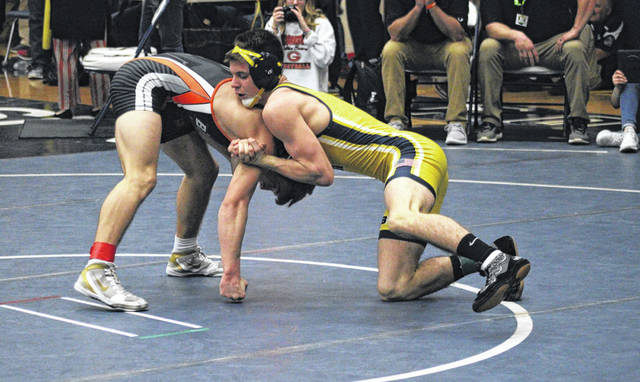 Brennan Short of Archbold, right, wrestles against Connor Smith of Gibsonburg at a Division III district tournament in Napoleon earlier this month. Due to the cancellation of all winter sports tournaments because of the COVID-19 pandemic, Short will not be able to finish his senior season.