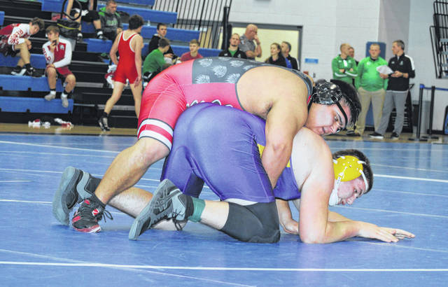 Sammy Sosa of Wauseon, top, wrestles against Christian Hollister of Bryan in the 285-pound semifinal Saturday. The Indians, behind five individual sectional champions, claimed the overall team title.