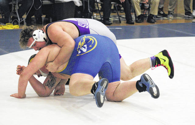 Brodie Stevens of Swanton, top, wrestles against Joseph Miller of Northwood Friday on the first day of competition at the Division III district tournament held at Napoleon. He would take runner-up at 285 pounds.