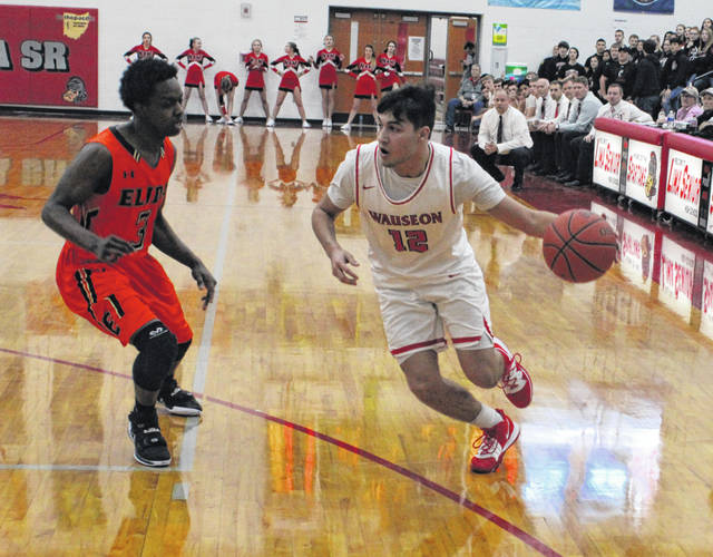 Noah Tester of Wauseon handles the ball in a sectional final played at Lima Senior Friday night. He led all scorers with 24 points, helping the Indians to a 62-40 win over Elida.
