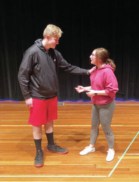 "Prior to school-related activities being cancelled, Garrett Brown and Olivia Clark, playing Mufasa and Simba, rehearse a scene for the Wauseon High School production of ""The Lion King Jr.,"" that was scheduled April 3-5. In a second photo, Scar, as played by Uzziah DeLaCruz, reacts in a dramatic scene with Clark and Brown."