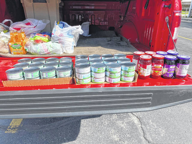 Over 70 cans of tuna, chicken, cereal, soups and other items have been donated by Pike-Delta-York teachers to Delta Outreach.