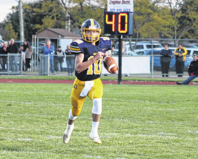 Archbold quarterback D.J. Newman scrambles for a first down in a regular season game versus Liberty Center last season. The Blue Streaks, along with other area schools, will stay in Division VI but move from Region 23 to Region 22 in 2020.