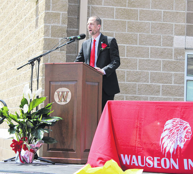 Principal Keith Leatherman speaks at the beginning of ceremony.