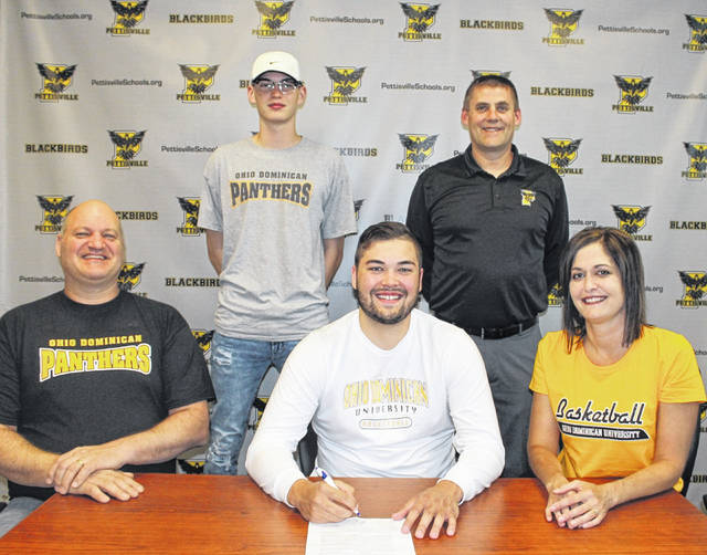 Pettisville's Graeme Jacoby will be furthering his academic and basketball career at Ohio Dominican University in Columbus. Front row, from left: John Jacoby (father), Graeme, Callie Jacoby (mother). Back row: Cayden Jacoby (brother) and Pettisville basketball coach Brian Leppelmeier.