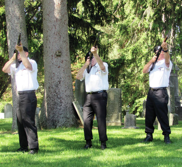 A three volley salute is fired at a recent Memorial Day ceremony in Wauseon. This year's event will be downsized due to COVID-19.