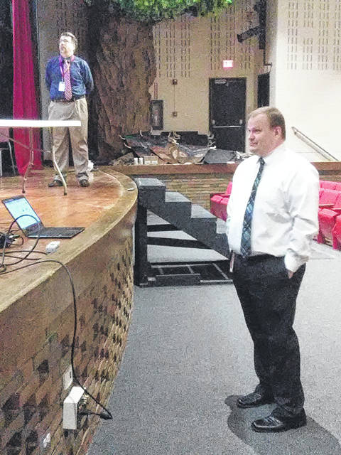 Don Clark, left, and Jason Robinson on Monday discussed upgrades to the Wauseon High School auditorium with the Board of Education.