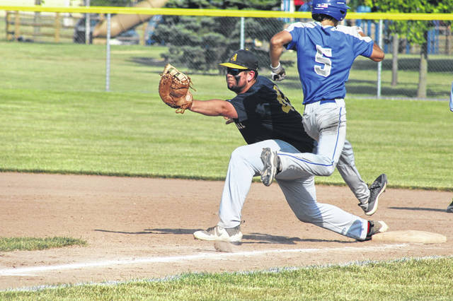 Archbold first baseman Drake Mohring stretches to record an out during Monday's doubleheader against Defiance. The Blue Streaks took the first game 9-3, but fell in game two 5-1.