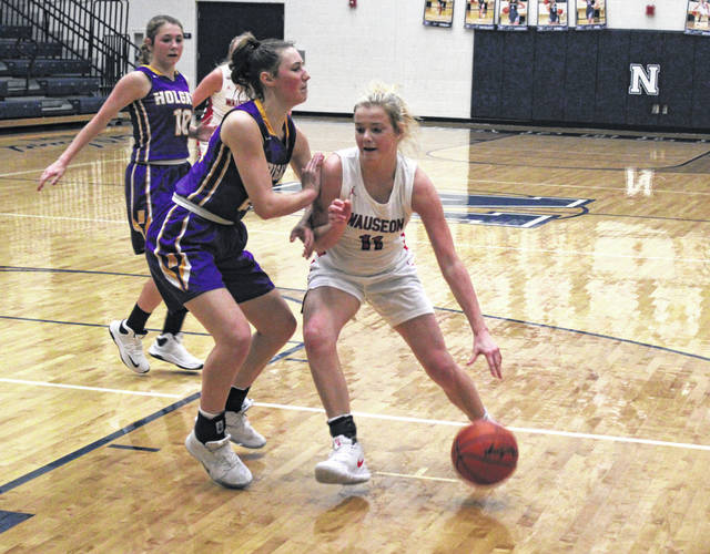 Chelsie Raabe of Wauseon drives into the lane versus Holgate during a game last season. The Indians will drop down and compete in Division III for the 2020-21 season.