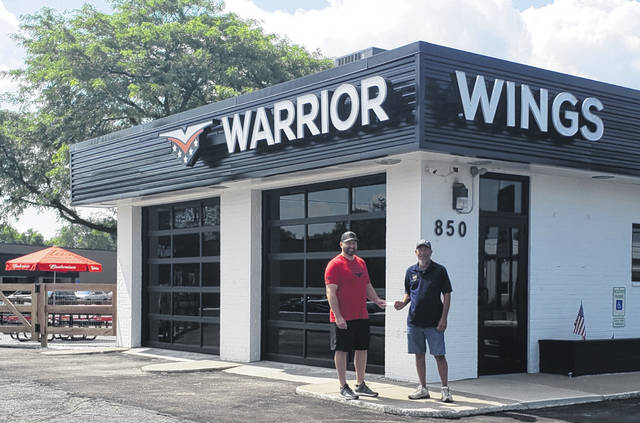 Due to customer support since its opening, Warrior Wings was able to donate $2,000 to be used for up to 10 more veteran banners in Wauseon. Pictured are Brock Nagel, owner of Warrior Wings, and Bill Pursel, American Legion Commander, right. Those that would like to donate money for banners can call the American Legion at 419-337-8383.