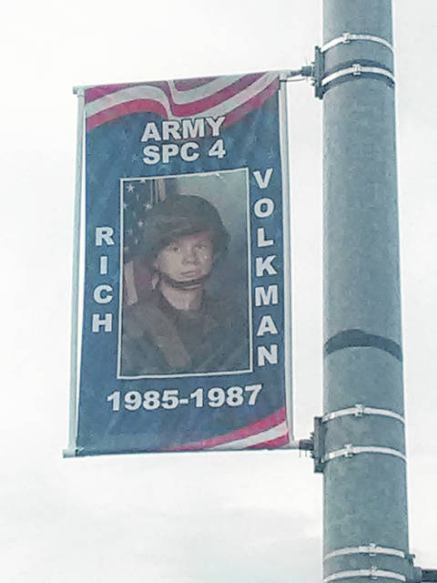 Army veteran Rich Volkman appears on a banner placed at Fulton and Oak streets in Wauseon.
