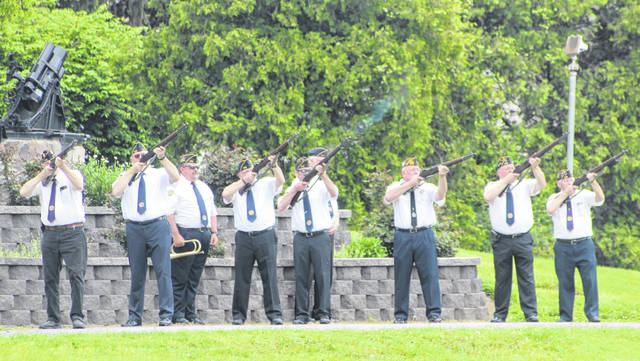 """It was scaled down, but Memorial Day was still observed in Swanton on May 25. The Honor Guard visited multiple locations, including the Doughboy Statue in Memorial Park, above. A three-volley salute was performed and """"Taps"""" was played in honor of the fallen."""
