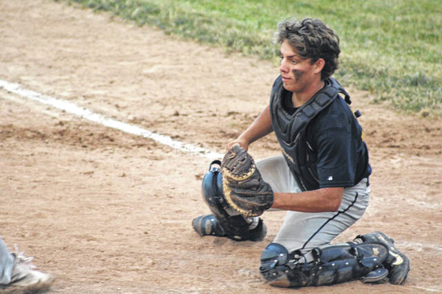 Archbold catcher Zane Behnfeldt prepares to tag out Bryan's Dylan Dominique at the plate during the bottom of the second inning of Monday's game. This completed a double play, subsequently ending the second inning.