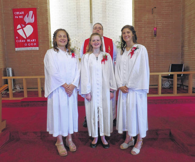 St. Luke Lutheran Church held Confirmation on June 28. Pictured are Vivian Gebers, Mina Wesche and Eliza Jones with Rev. Chris Sigmon.